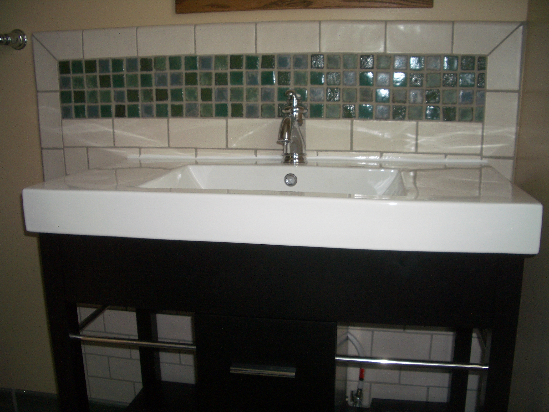 after the new sink and tile backsplash adds beauty and functionality